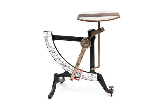 Vintage letter scale with enamel scales, isolated with white background