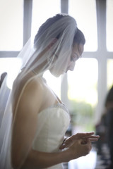 Young bride looking down at her wedding ring.