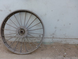 old wheel on a wall