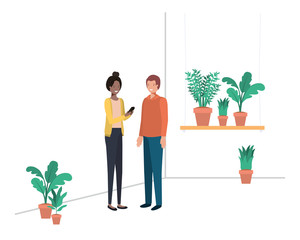 young couple with house plant and smartphone