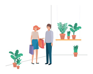 couple with house plant and shopping bags
