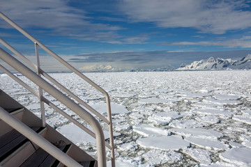Staircase on boat with icebergs in background, Antarctica