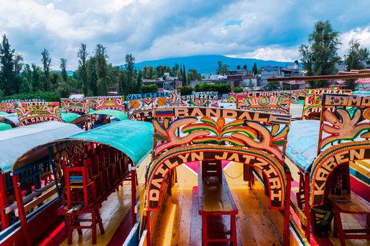 Mexican colorful trajineras on Xochimilco's lake.