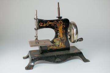 Child's antique sewing machine