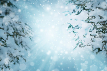 CHRISTMAS BACKGROUND WITH SNOW AND BOKEH LIGHT