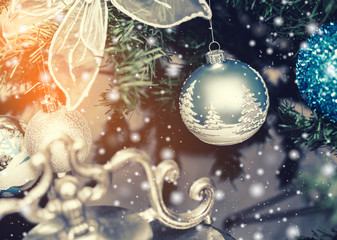 Christmas tree background and Christmas decorations with snow, blurred, sparking, glowing. Happy New Year and Xmas theme.