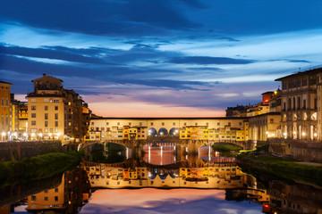 Fototapete - Ponte Vecchio bridge in Florence under sunset, Italy