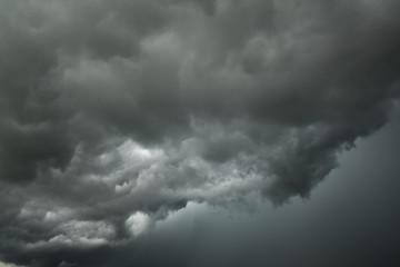 Motion of dark sky and black clouds, Dramatic cumulonimbus cloud with rainy Wall mural