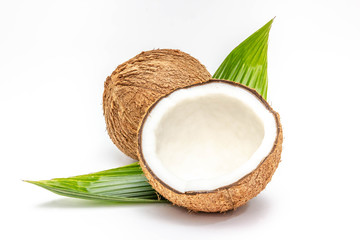 Coconut with half and leaves on white background