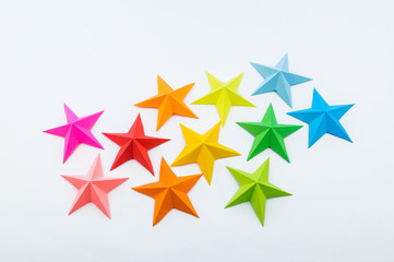 A star made of rainbow-colored paper