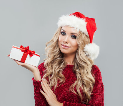 Beautyful blonde woman with christmas gift box on white background