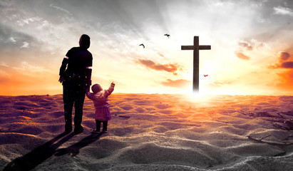 Worship concept: mother with children in front of the cross Wall mural