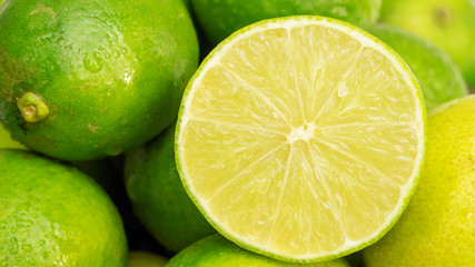 Close up of a half of green lime in a basket.