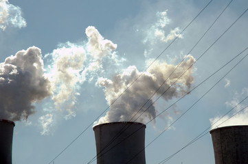 Steam Rises from Energy Company Chimney Stack