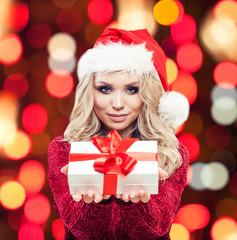 Christmas woman and christmas gift box on abstract bokeh background