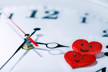 Time love concept. Arrow of clock show on the two hearts with smile. Valentine day.
