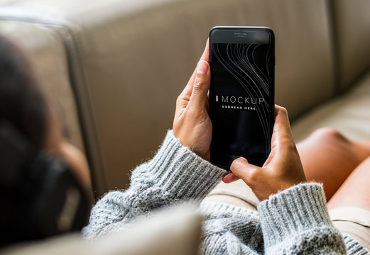 Woman using a mobile phone mockup