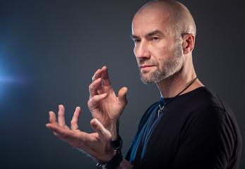 Brutal bald man, dark background