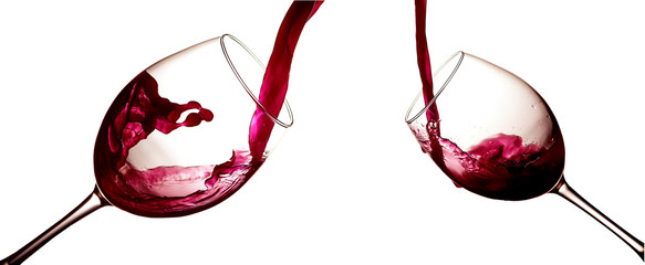 Red wine pouring in wineglasses on white background. Anniversary, Valentines or Christmas concept.