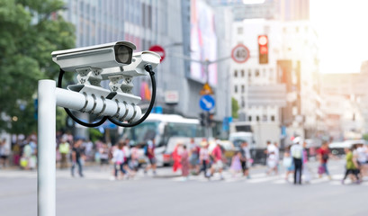 Fototapete - Machine Learning analytics identify person technology , Artificial intelligence ,Big data , iot concept. Cctv , security camera and face recognition people in smart city traffic.