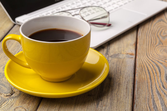 Workplace with office tools and gadgets. Cup of coffee on a table