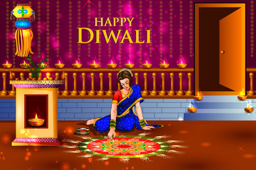 Lady making Rangoli for Happy Diwali to celebrate Holiday of India