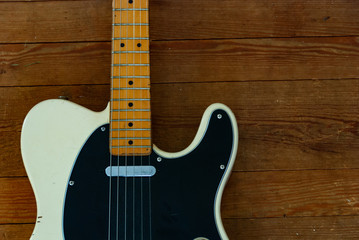 Vintage Electric Guitar on a Wooden Floor