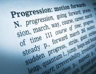 CLOSE UP OF DICTIONARY PAGE SHOWING DEFINITION OF THE WORD PROGRESSION