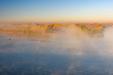 Fog over the water on a river Dnieper on autumn