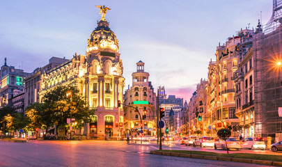 Madrid city skyline gran via street twilight , Spain