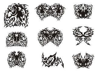 Monster horse symbol and butterflies created from it. Flaming abstract ethnic butterfly wings in black and white tones for your design