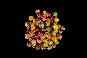 multicolored caramel popcorn on a black background.