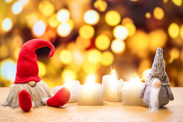 Two christmas dwarfs with bokeh lights in background