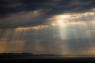 Dramatic cloud formations with the rays of the sun shining through at Jeffreys Bay in South Africa