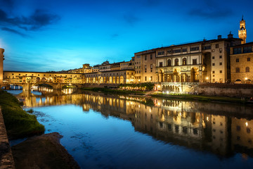 Evening view of the famous bridge Ponte Vecchio and Uffizi Gallery on the river Arno in Florence, Italy.