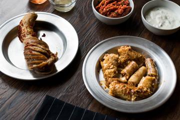 Turkish Food Minced Meat and Rice Stuffed Tripe Mumbar Dolma with Sirdan / Shirdan Dolmasi.
