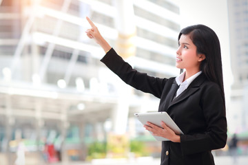 businesswoman using tablet and pointing fingure