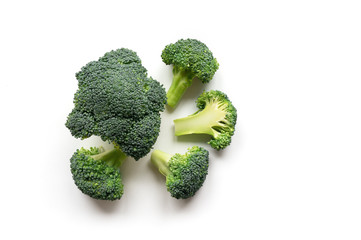 Isolated Broccoli. Green vegetables on white background. Top view.