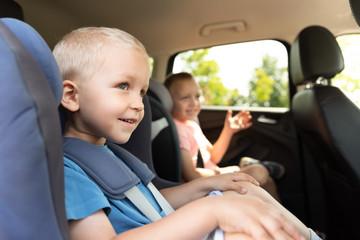 Boy buckled into car seat