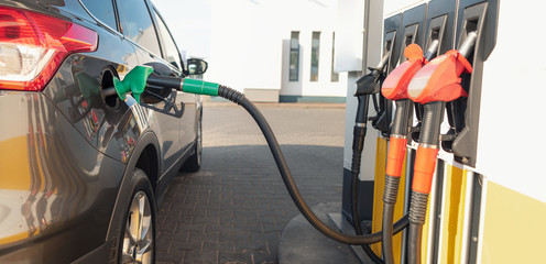 Refueling the vehicle at a gas station