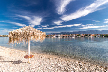 Straw umbrella on Croatian Beach, Novalja