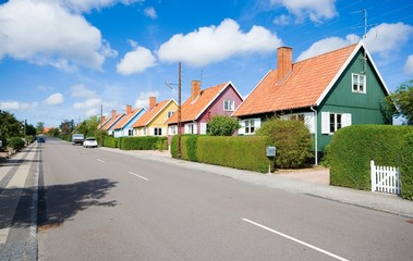 Traditional colorful wooden Swedish houses in the suburbs of Nexo, Bornholm, Denmark. The houses are the gift from Swedish state after the end of the Second World War