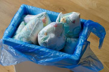 trash bin full of used diapers