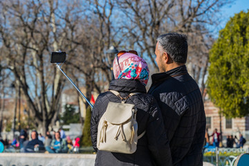 People on the streets of Istanbul take selfie photos.