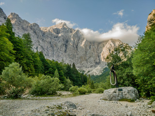 Landscape picture of hills with monument in Triglav national park in Slovenia.