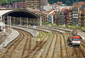 Fotobehang Treinstation Aerial view of locomotive train running along the railway track and train station in Bilbao, Spain
