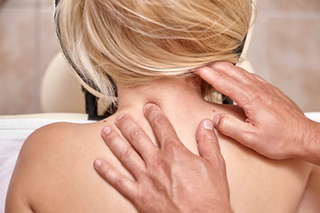 close up, physiotherapist massage woman neck. elevated view, rear view.