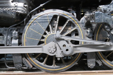 Old steam train wheel and rods.