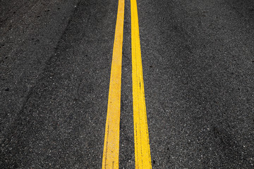Yellow double dividing lines, highway road