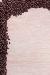 wooden background with black coffee beans .photo with copy space